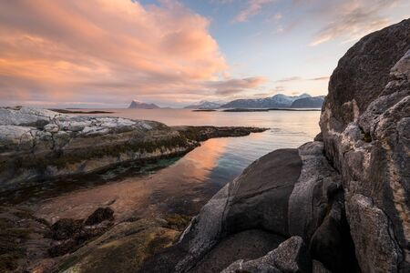 An early morning seascape photographed at sunrise in the small fishing village of Sommaroy, Norway.