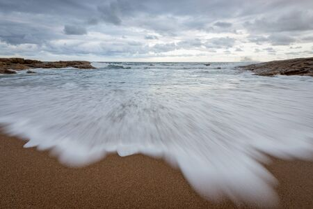 A misty seascape photographed on a cloudy, stormy day near the Marina beach in South Africa.