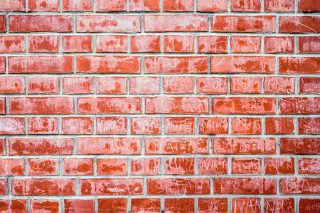An abstract close up of a red brick wall near Dubrovnik, Croatia, with graffiti on the brickwork. Standard-Bild