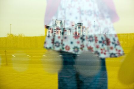 A colourful abstract reflection of a girl's clothing in a shop window, taken in England. Standard-Bild