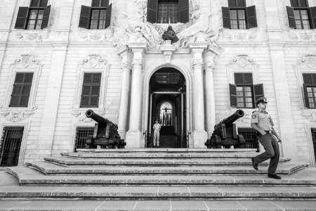 A black and white photograph of the front of the Il-Berga building in Valletta, Malta. Editorial