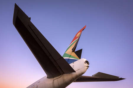 A close up tail shot of a retired South African Airways boeing taken at sunrise in Johannesburg, South Africa.