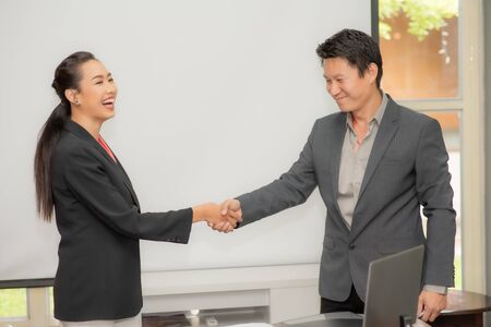 Business colleagues handshake. Businesspeople shaking hands after a successful meeting Stok Fotoğraf