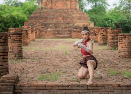 Thai Boxing Women prepare to training boxing and kickboxing for exercise at the old temple.