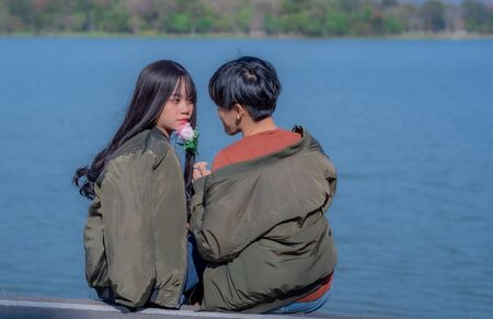Attractive young Asian women couple in love having fun and hugging.