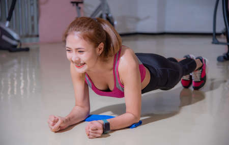 Asian woman exercising in the gym, She was pretending to