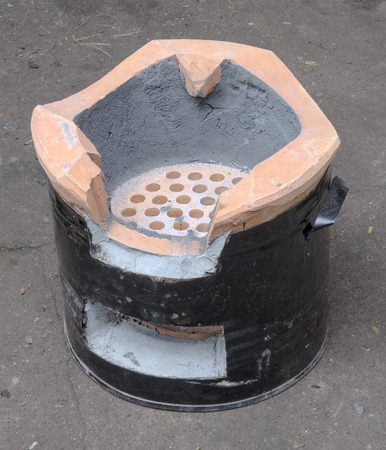 stoking: The Charcoal stove of thai style. Stock Photo