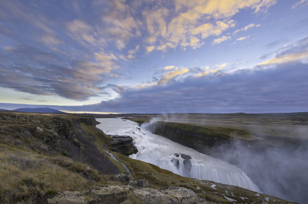 tremendous: Dettifoss. Situated in Vatnajokull N.P. in Northeast Iceland, its the most powerful waterfall in Europe. Photo taken from the east bank at sunrise. Stock Photo