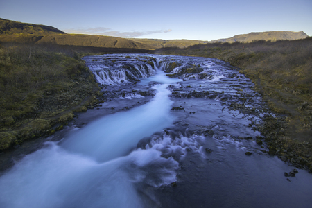 Bruarfoss (Bridge Fall), is a waterfall on the river Bruara, in southern Iceland where a series of small runlets of water runs into a beautiful, turquoise-blue colored pool. Stock Photo
