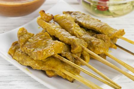 pork satay with peanut sauce or sweet and sour sauce, thai food