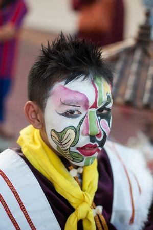 appalling: UDONTHANI, THAILAND - DECEMBER 1, 2012  Tradition in Udonthani, Between 1 - 15 December of each year at Udonthani, Unidentified men, Participants parade rest before the start of the show at the event on DECEMBER 1, 2012 in UDONTHANI, THAILAND