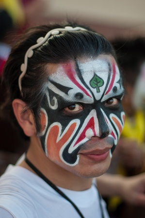 zatrważający: UDONTHANI, THAILAND - DECEMBER 1, 2012  Tradition in Udonthani, Between 1 - 15 December of each year at Udonthani, Unidentified men, Participants parade rest before the start of the show at the event on DECEMBER 1, 2012 in UDONTHANI, THAILAND