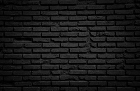 Black brick wall for background. Banco de Imagens