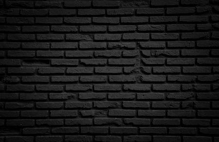 Zwarte bakstenen muur voor achtergrond. Stockfoto