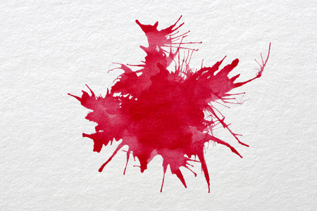 Drop the red watercolors on white paper. Stock Photo