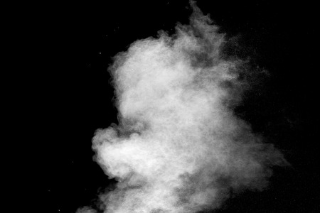 Explosion of white dust on black background.