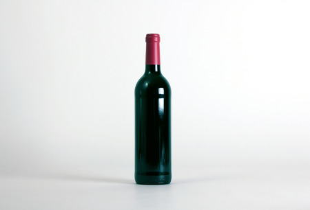 unlabeled: An unlabeled red wine bottle isolated on white background