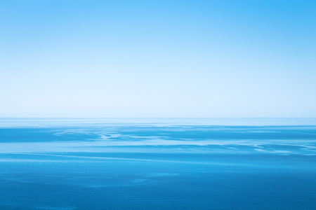 Blue unearthly ocean. Blue planet. Water sky blue clear sky 写真素材