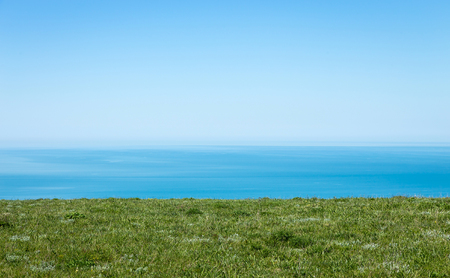 Beautiful seascape. Calm turquoise sea with a clear sky, the view from the high coast.