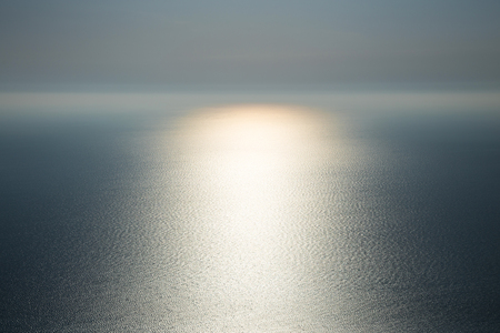 The magic of nature. Light on water. Gentle beautiful seascape in the Atlantic ocean with glowing solar path.