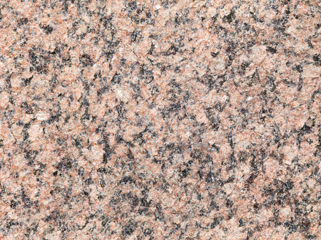 Granite stone texture. Building wall polished of beautiful color: pink with black 写真素材