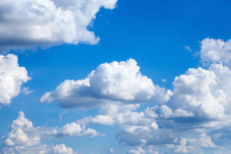 Cloudscape Blue sky with large white clouds. Beautiful big clouds slowly float against the blue sky. 스톡 콘텐츠