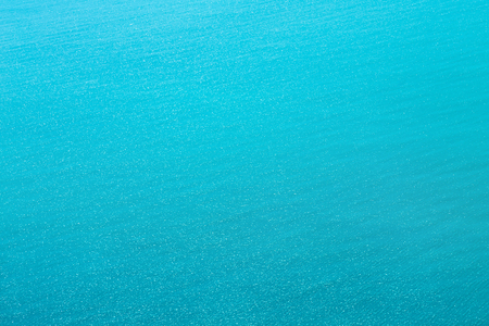 Sea texture of sparkling blue water. Water in sunny day.