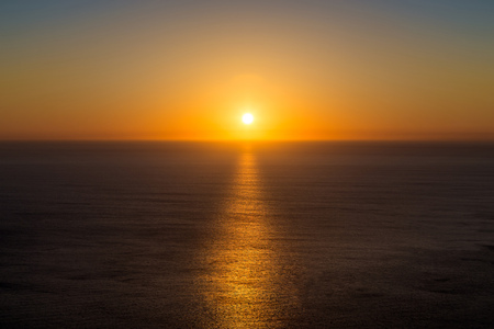 Beautiful sunset over the sea in the Atlantic ocean. Solar path on the water