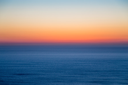 Seascape with colorful evening sky. Natural background. Beautiful sunset over the sea in the Atlantic ocean.