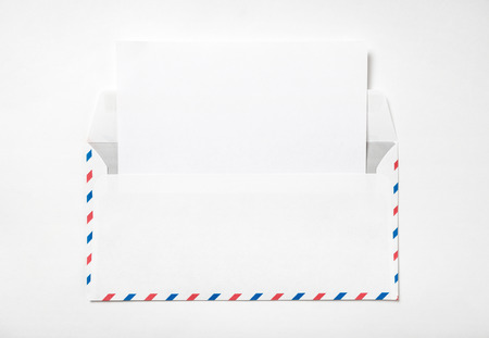 Open envelope with a sheet of paper. Blank airmail envelope with letter template on a white background. Back view