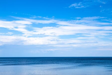 Beautiful blue seascape with white clouds in the sky. Great Ladoga lake, Karelian sea.