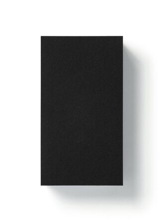 Blank black business card isolated on white background. Top view. Standard size. Stylish textured stack of cardboard for personal advertising or corporate design. Imagens
