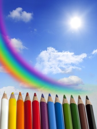 Crayons clouds rainbow and sun concept background