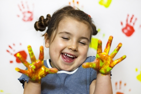 Kid playing with paint Stock Photo - 13647078