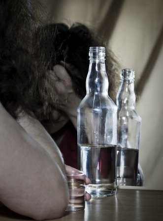 abuse young woman: Alcoholic drinking to mirror