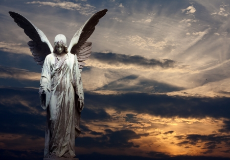 angel and sunset abstract background