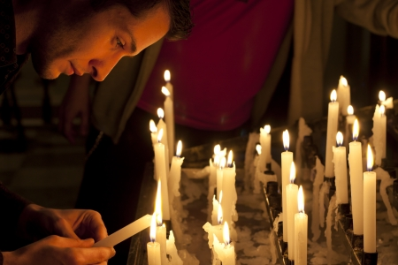 Prayer in church and candles photo