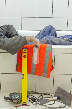 drunk worker in the bath Stock Photo - 13711653