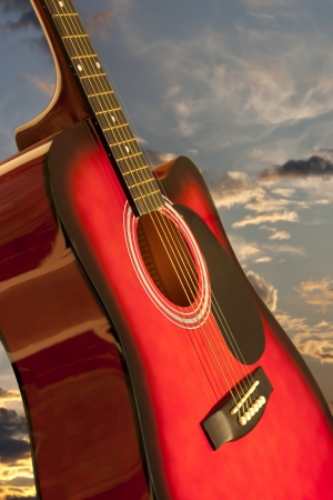 Guitar and romantic sky photo