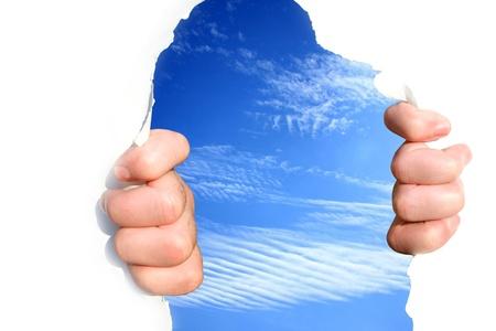 Hands on the sky tear a hole Stock Photo - 13711542