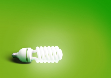energy conservation: Green bulb abstract background Stock Photo