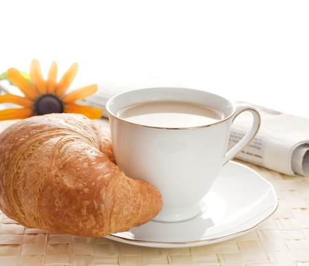 croissants: Morning breakfast with newspaper Stock Photo