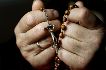Praying woman hands and rosary Stock Photo - 13740296