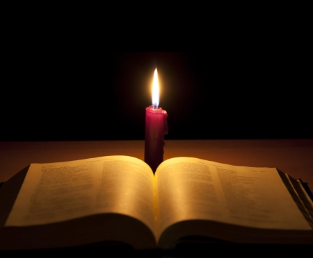 bible and candle background photo