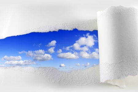 imploring: Torn paper on blue sky abstract background