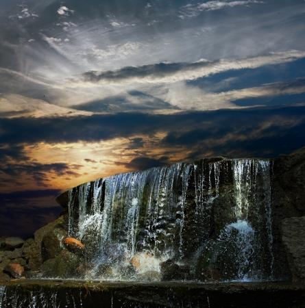 colrful: Waterfall at night at sunset Stock Photo