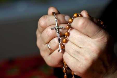 black jesus: Praying woman hands Stock Photo