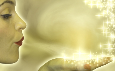 gold woman: woman blowing stars hand presentation