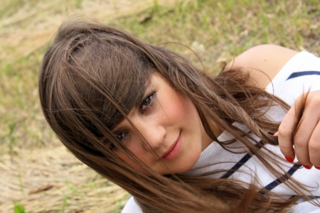 portrait of young beautiful teen on the meadow closeup photo