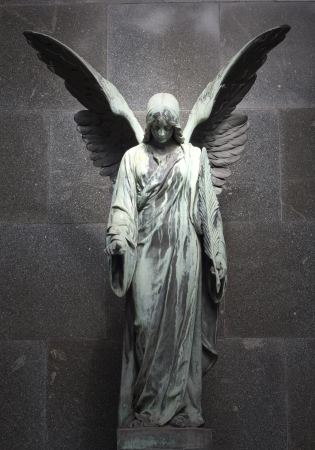 praying angel: sculpture of an angel with  dark background  Stock Photo